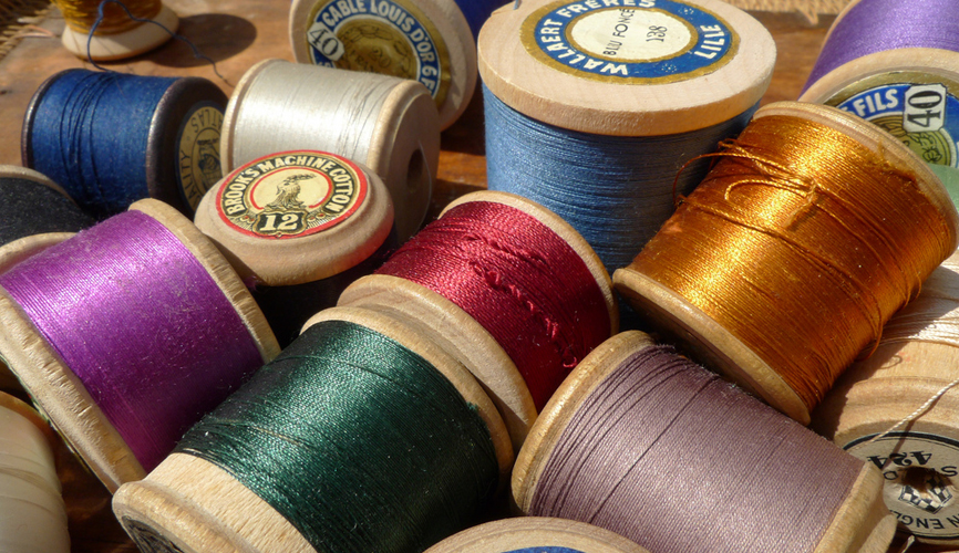 different coloured spools of thread