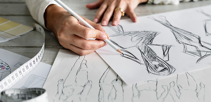 woman sketching pattern designs